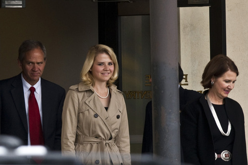 Chris Detrick  |  The Salt Lake Tribune   Elizabeth Smart and her parents Lois and Ed Smart walk out of the Frank Moss Federal Courthouse in Salt Lake City during the Brian David Mitchell trial Wednesday November 10, 2010.