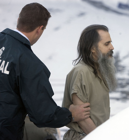 Al Hartmann  |  The Salt Lake Tribune A shackled Brian David Mitchell is spotted by federal marshall as he makes his way across snowy lot into the Frank Moss Federal Building in Salt Lake City on Monday, Nov. 28. Trial resumes on charges he kidnapped Elizabeth Smart.