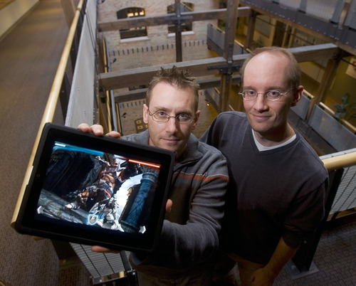 Al Hartmann     The Salt Lake Tribune  Donald, left, and Geremy Mustard, (the Mustard Brothers)' show a screen shot on an I-Pad of their game app. called Infinity Blade.  Their new iPhone game has great 3D graphics and warranted mention by Apple's Steve Jobs.