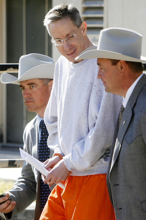 Patrick Dove  |  Standard-Times Warren Jeffs is escorted from the Tom Green County Courthouse in Texas in December. Jeffs is in a Texas jail awaiting trial on sexual assault and bigamy charges but has retaken his post as president of the Fundamentalist Church of Jesus Christ of Latter Day Saints, according to a document filed with the Utah Department of Commerce.
