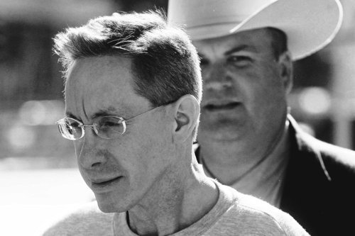Warren Jeffs, leader of the Fundamentalist Church of Jesus Christ of Latter Day Saints, is escorted under guard from the Tom Green County Courthouse in 2010. Photo by Patrick Dove/Standard-Times