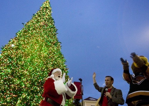 Djamila Grossman  |  The Salt Lake Tribune  West Valley City Mayor Mike Winder, the Utah Grizzlies mascot and Santa Clause cheer after the mayor lit the Christmas Tree at Valley Fair Mall in West Valley City, Saturday, Nov. 27, 2010.
