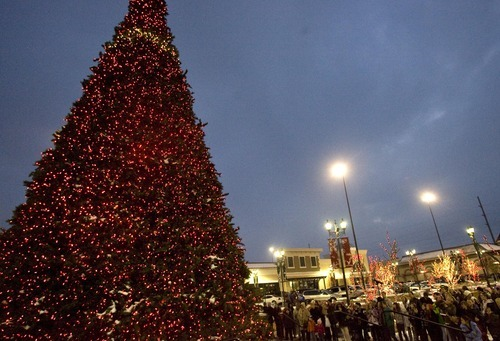 Djamila Grossman  |  The Salt Lake Tribune  People watch as the Christmas Tree is lit at the Valley Fair Mall by Mayor Mike Winder, in West Valley City, Saturday, Nov. 27, 2010.