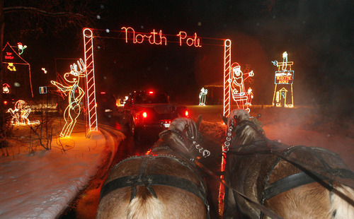 file the salt lake tribune a family takes a ride on a horse drawn - Willard Bay Christmas Lights