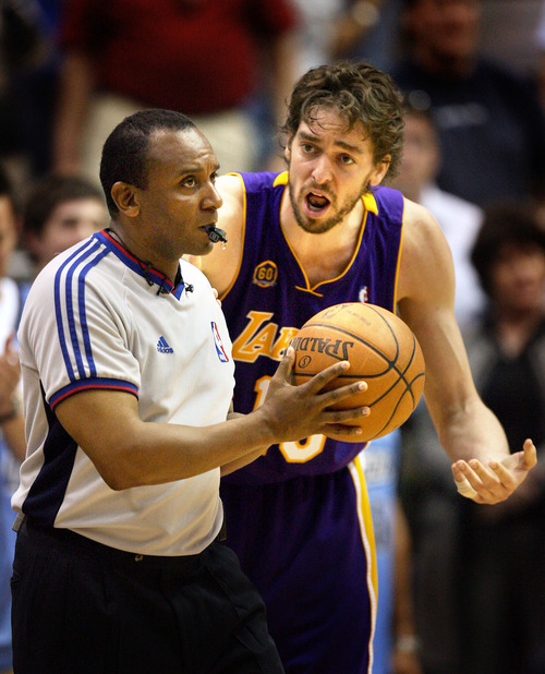 Los Angeles' Pau Gasol complains to referee Eddie F. Rush during the fourth quarter after Rush whistled him for a foul.   Scott Sommerdorf/The Salt Lake Tribune