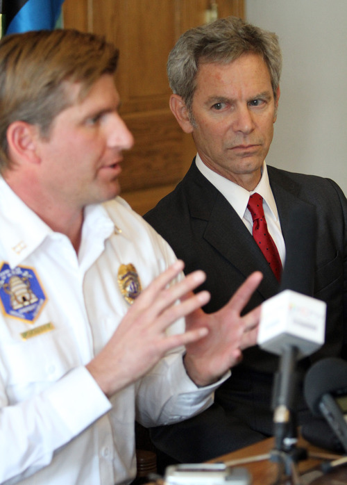 Salt Lake City Mayor Ralph Becker listens to Public Information Officer Michael Harp during a press conference about a Chevron oil spill at the University of Utah. Approximately 100 barrels of crude oil was released near Red Butte Canyon. Stephen Holt / Special to the Tribune