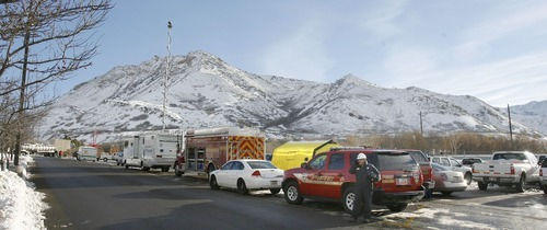Steve Griffin  |  The Salt Lake Tribune   Salt Lake City Fire Department, Chevron, and other hazardous materials tems  gather near the site of an oil spill by the Red Butte Amphitheater in Salt Lake City Thursday, December 2, 2010.