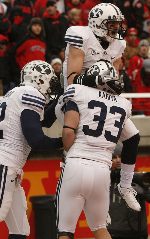 Trent Nelson     The Salt Lake Tribune  BYU receiver McKay Jacobson (6) celebrates his touchdown with BYU running back Bryan Kariya (33) and BYU running back Mike Hague (32) as the Utes face BYU in the third quarter at Rice-Eccles Stadium Saturday, November 27, 2010.