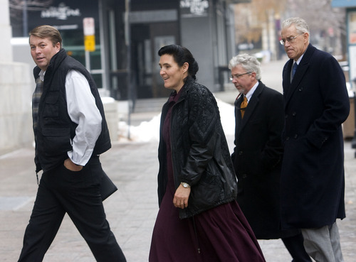Al Hartmann  |  The Salt Lake Tribune  Wille Jessop, left, of the United Effort Plan, (UEP),  enters the Frank Moss Federal Courthouse in Salt Lake City on Friday December 2nd.  Attorney Jim Bradshaw is at far right.