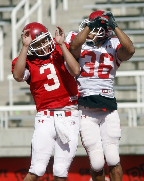 Steve Griffin  |  The Salt Lake Tribune  Utah quarterback Jordan Wynn, left, leaps into the air with running back Eddie Wide in the end zone after Wide scored a touchdown during the University of Utah football scrimmage at Rice Eccles Stadium inSalt Lake City on Thursday, August 12, 2010.