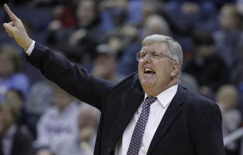 Utah State head coach Stew Morrill gestures during the first half of an NCAA basketball game against Georgetown Saturday, Dec. 4, 2010, in Washington.Georgetown won 68-51. (AP Photo/Luis M. Alvarez)