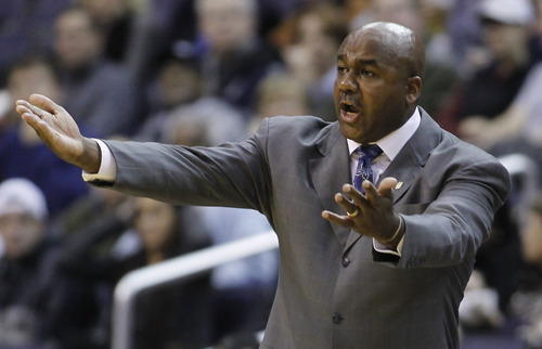 Georgetown head coach John Thompson III argues a call during the first half of an NCAA basketball game against Utah State Saturday, Dec. 4, 2010, in Washington. Georgetown won 68-51. (AP Photo/Luis M. Alvarez)