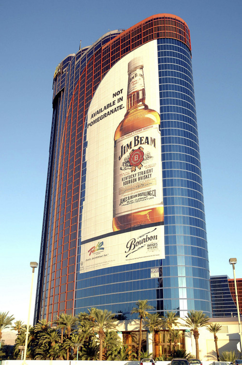 File - In this undated photo provided by BeamGlobal.com, the world's largest distilled spirits ad is wrapped around the Rio All-Suite Hotel & Casino on the Las Vegas Strip. Consumer products maker Fortune Brands Inc. said Wednesday, Dec. 8, 2010, it plans to split into three companies, keeping its liquor business led by Jim Beam bourbon while shedding the units that make Titleist golf balls, Moen faucets and Master Locks. (AP Photo/PRNewsFoto, BeamGlobal.com)** NO SALES **