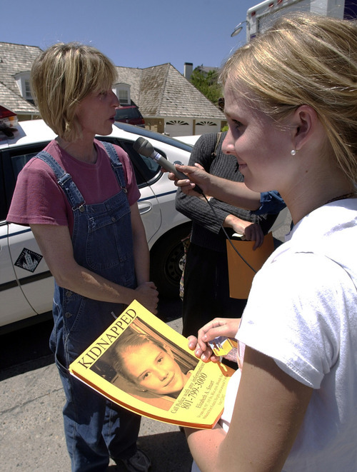 Steve Griffin  |  The Salt Lake Tribune  Diane Langeland (left) and her 16-year-old daughter Kate Langeland prepare to pass out fliers containing information on Elizabeth Smart, who was kidnapped from her Salt Lake City home early June 5, 2002. The Langelands, along with other members of the LDS ward that Smart attended, printed the fliers and passed them out to area businesses.