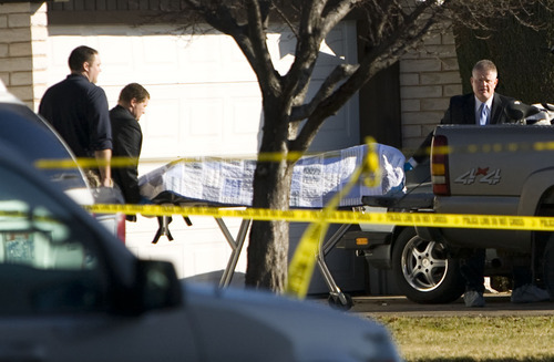 Samantha Clemens  |  The Spectrum One of two female victims is removed from a crime scene Saturday morning at 575 S. Main St. in St. George. Two young women are dead and one man is injured after an overnight shooting.