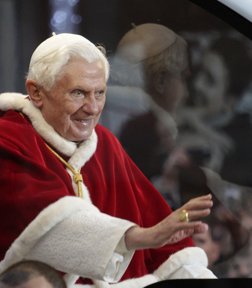 Paolo Cito  |  The Associated Press Pope Benedict XVI waves to faithful this week in Rome.