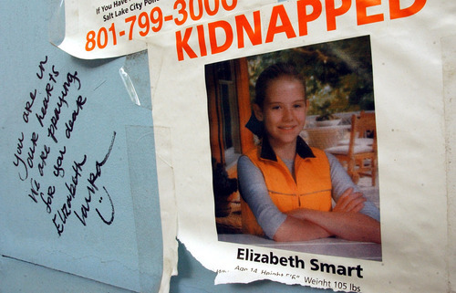 Rick Egan | The Salt Lake Tribune A poster for Elizabeth Smart and a note are seen on a kiosk on Main Street in Salt Lake City shortly after Elizabeth Smart's abduction from her home in 2002.
