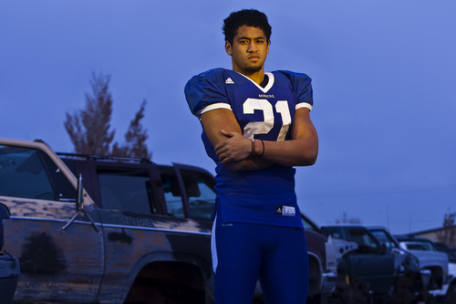 Chris Detrick  |  The Salt Lake Tribune  Bingham's Harvey Langi poses for a portrait at Butcher Auto Wrecking on Wednesday, Dec. 8, 2010.