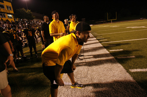 Scott Sommerdorf  l  The Salt Lake Tribune Cottonwood head coach Josh Lyman looks on as his team puts the final touches on an emotional, 28-21 win over Alta at Cottonwood High School on Friday, Aug. 20, 2010. It was the first win for Lyman as head coach after six years as the Colts' assistant. Cottonwood won with Kami Sofele's interception return for a TD late in the game.