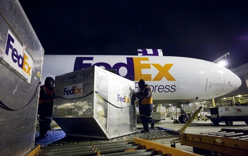 Mark Lennihan | The Associated Press  Shipping containers are unloaded from a FedEx cargo plane at the FedEx facility at Newark Liberty International Airport in Newark, N.J., Dec. 9 The company is gearing up for the holidays, when it expects to move nearly 16 million packages on the busiest day, about 11 percent higher than last year. The company benefits from an increase in online holiday gift-buying.