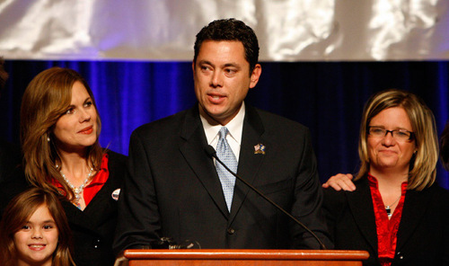 Newly elected congressman Jason Chaffetz is flanked by wife Julie and daughter Kate, 7, left, and campaign manager Jennifer Scott, right, as he addresses  supporters during election night celebrations at the Utah Republican Party headquarters at the Grand America Hotel in Salt Lake City on Tuesday,  November 4, 2008.  Steve Griffin/The Salt Lake Tribune