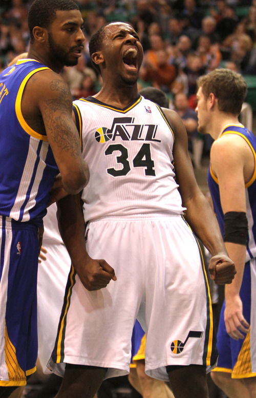 Rick Egan      The Salt Lake Tribune   C.J. Miles (34)  reacts after scoring for the Jazz,  in NBA action, Utah Jazz vs. The Golden State Warriors,  Monday, December 13, 2010