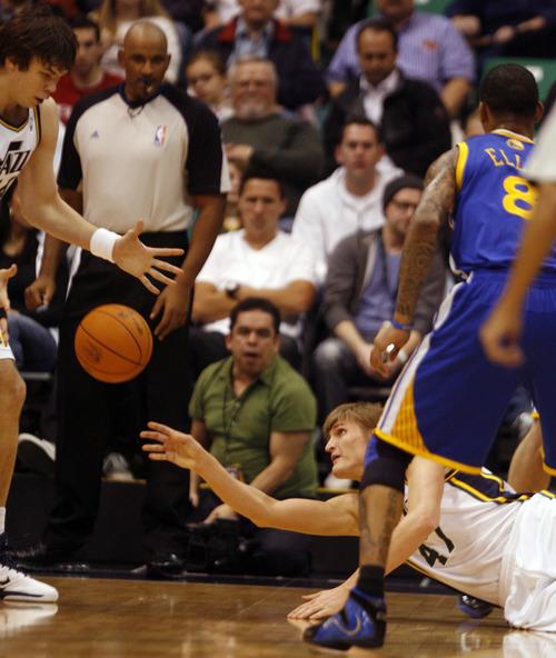 Rick Egan      The Salt Lake Tribune   Utah Jazz forward Andrei Kirilenko (47), grabs a loose ball and dishes if off to Utah Jazz center Kyrylo Fesenko (44), in NBA action, Utah Jazz vs. The Golden State Warriors,  Monday, December 13, 2010