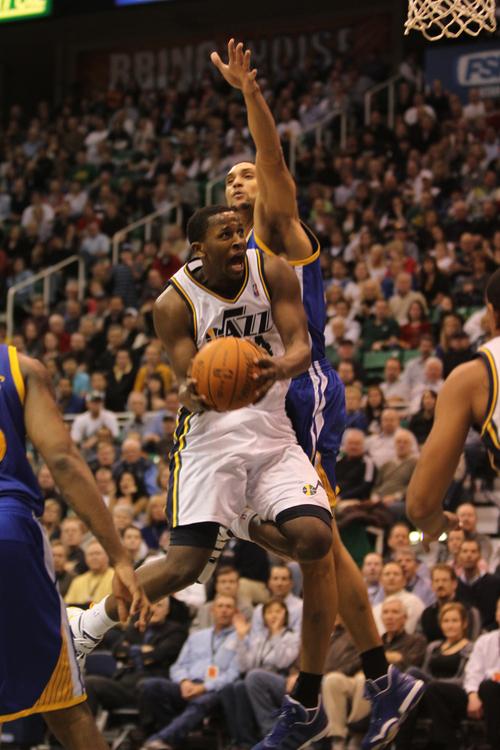 Rick Egan      The Salt Lake Tribune  Utah Jazz forward C.J. Miles (34) scores on a fast break,  in NBA action, Utah Jazz vs. The Golden State Warriors,  Monday, December 13, 2010