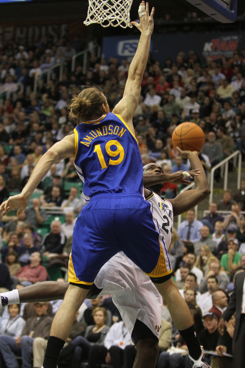 Rick Egan      The Salt Lake Tribune  Utah Jazz forward Paul Millsap (24)  shoots over Golden State Warriors' Lou Amundson (19), in NBA action, Utah Jazz vs. The Golden State Warriors,  Monday, December 13, 2010
