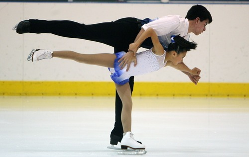 Steve Griffin  |  The Salt Lake Tribune  Caroline Yu and Brian Johnson twirl in a circle during the intermediate pairs event at the U.S. Junior Figure skating championships at the Salt Lake City Sports Complex  Friday, December 17, 2010.