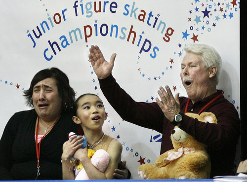 Scott Sommerdorf  l  The Salt Lake Tribune Karen Chen of the Peninsula Skating Club is flanked by coaches Sherri Krahne-Thomas (cq-left) and Gilley Nicholson as they react to the announcement of her winning scores. She placed first with an overall score of 119.92 on the final day of the US Junior Figure Skating Championships, Saturday 12/18/2010.