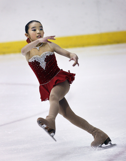 Scott Sommerdorf  l  The Salt Lake Tribune Karen Chen skates during her winning program in the Intermediate Ladies Final in the US Junior Figure Skating Championships, Saturday, 12/18/2010. Chen won the competition with an overall score of 119.92. Elena Taylor was second with a score of 106.80.