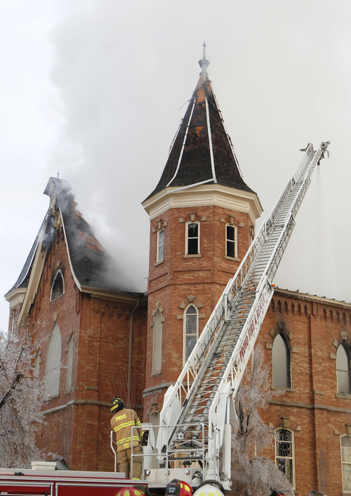Provo firefighters battle a fire at the historic Provo Tabernacle Friday, Dec. 17, 2010 in Provo.  The historic tabernacle, which is owned by the Mormon church and is used for religious services and community events, was built in 1873. (AP Photo/George Frey)