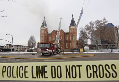 Provo firefighters battle a fire at the historic Provo Tabernacle on Friday, Dec. 17, 2010 in Provo.  The historic tabernacle, which is owned by the Mormon church and is used for religious services and community events, was built in 1873. (AP Photo/George Frey)