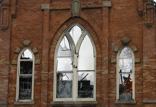 Rick Egan      The Salt Lake Tribune  Fire can be seen along with icicles in the windows of the Provo Tabernacle, around noon, Friday, Dec. 17, 2010.