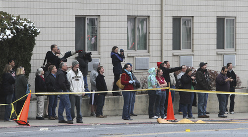 Rick Egan   |  The Salt Lake Tribune  Onlookers gather near the Travel Lodge, to get a look at the Provo Tabernacle, Friday, December 17, 2010.