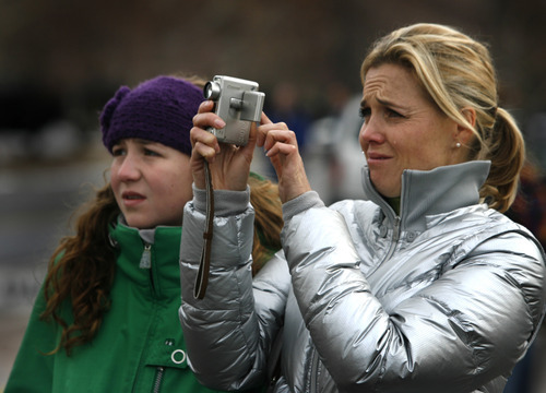 Rick Egan      The Salt Lake Tribune  Julie Reneer sheds a tear as she watches the the Provo Tabernacle go down in flames, with her daughter, Emily, 14, Friday, December 17, 2010.  Reneer, a native of Provo, has been attending church services in the building since she was a small child.