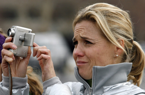 Rick Egan      The Salt Lake Tribune  Julie Reneer sheds a tear as she watches the the Provo Tabernacle go down in flames, Friday, December 17, 2010.  Reneer, a native of Provo, has been attending church services in the building since she was a small child.