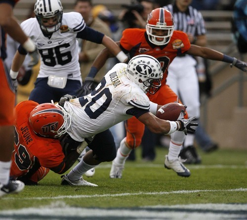 Trent Nelson  |  The Salt Lake Tribune BYU running back Joshua Quezada (20) stretches out for a touchdown as BYU defeats UTEP in the New Mexico Bowl, college football Saturday, December 18, 2010 in Albuquerque, New Mexico.