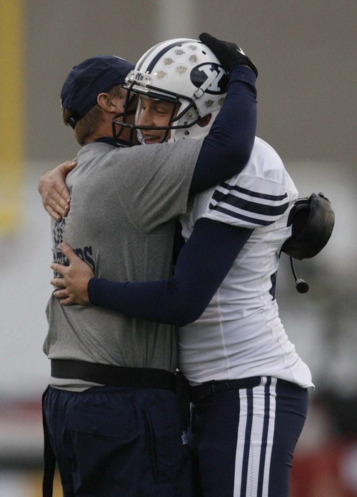 Trent Nelson  |  The Salt Lake Tribune BYU coach Bronco Mendenhall embraces BYU kicker Mitch Payne (a senior) as BYU defeats UTEP in the New Mexico Bowl, college football Saturday, December 18, 2010 in Albuquerque, New Mexico.