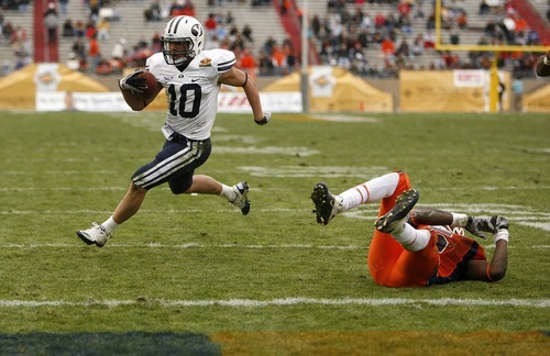 Trent Nelson  |  The Salt Lake Tribune BYU running back JJ Di Luigi (10) runs for a touchdown past a UTEP defender as BYU defeats UTEP in the New Mexico Bowl, college football Saturday, December 18, 2010 in Albuquerque, New Mexico.