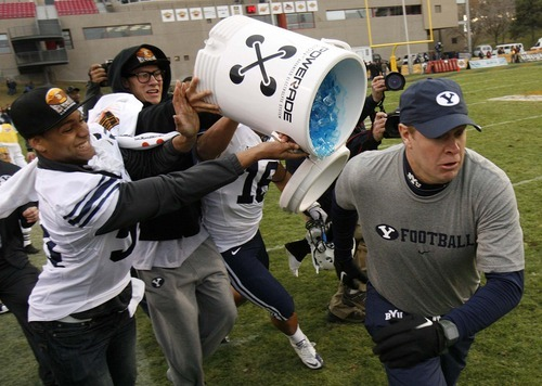 Trent Nelson  |  The Salt Lake Tribune BYU coach Bronco Mendenhall escapes a dunking in the final minutes as BYU defeats UTEP in the New Mexico Bowl, college football Saturday, December 18, 2010 in Albuquerque, New Mexico.