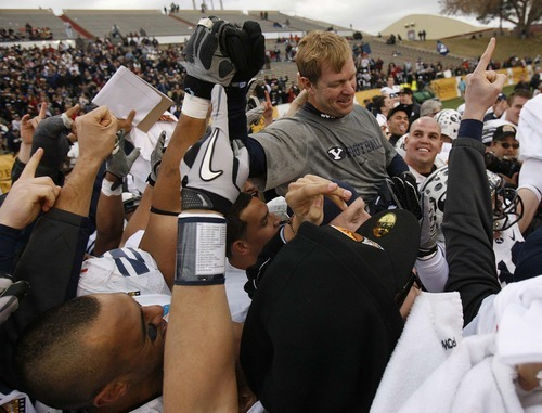 Trent Nelson  |  The Salt Lake Tribune BYU coach Bronco Mendenhall and his players celebrate as BYU defeats UTEP in the New Mexico Bowl, college football Saturday, December 18, 2010 in Albuquerque, New Mexico.