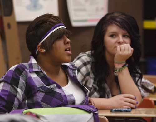 Leah Hogsten  |  The Salt Lake Tribune Dejianna Wilkinson (left) and Kayla Smith discuss the problems with stereotypes, of all kinds, at a meeting of the Clearfield High Gay-Straight Alliance. Dec. 9, 2010.