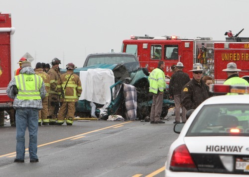 Rick Egan      The Salt Lake Tribune  Police and firefighters from Unified Fire, investigate a four car accident on highway 201 in Magna, Monday, December 20, 2010
