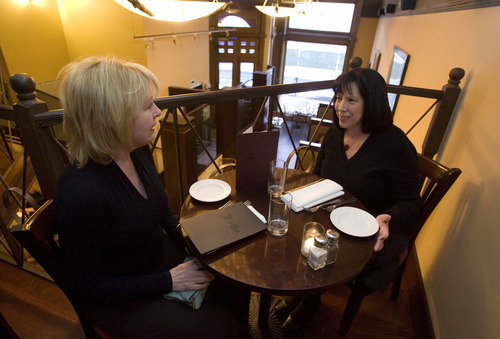 File  |  The Salt Lake Tribune Loretta Duncan, of Heber, left, and Marylou Mayer, of Clinton, chat at the Martine Cafe.