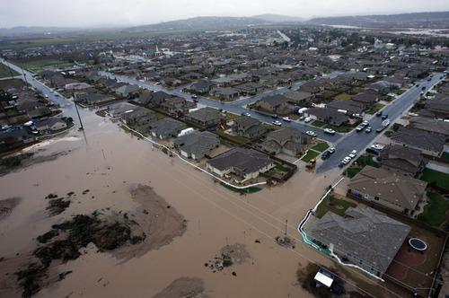 Rick Egan   |  The Salt Lake Tribune  Water flows into a neighborhood in Saint George, Tuesday, December 21, 2010