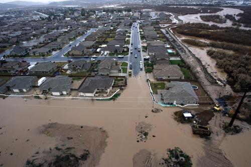 Rick Egan   |  The Salt Lake Tribune Floodwaters inundate a neighborhood in St. George Dec. 21, 2010.