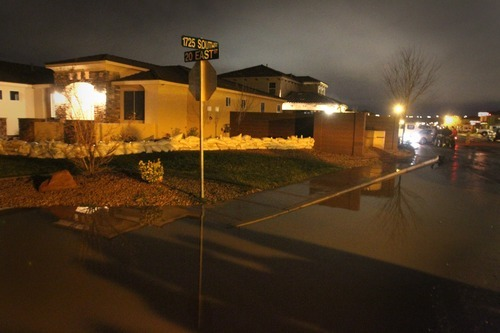 Rick Egan   |  The Salt Lake Tribune  Water surrounds the Kemp residence, in Stonegate subdivision, in Washington, Utah, Tuesday, December 21, 2010. Crews from Washington City were still pumping the water out of the streets late Tuesday night.
