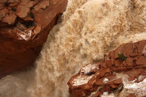 Trent Nelson  |  The Salt Lake Tribune Water churns over the spillway of the Gunlock Reservoir, Wednesday, December 22, 2010.